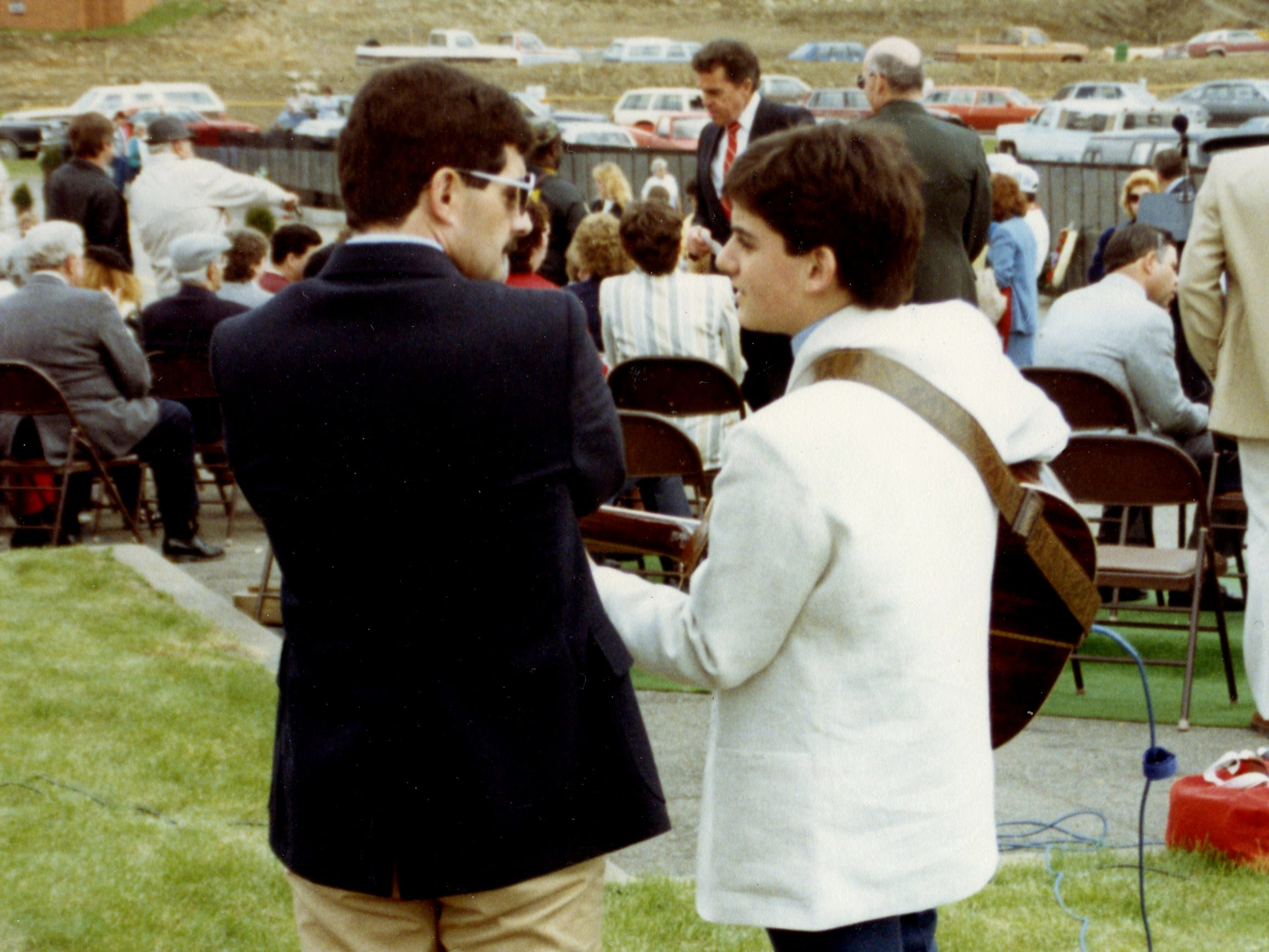 "Brad Paisley, right, then 15, and his father, Doug, in May 1988 before Brad Paisley sang ""God Bless the USA"" when a mobile Vietnam Veterans memorial wall stopped in Wheeling, W. Va. A local veterans group asked Brad Paisley to sing that day."