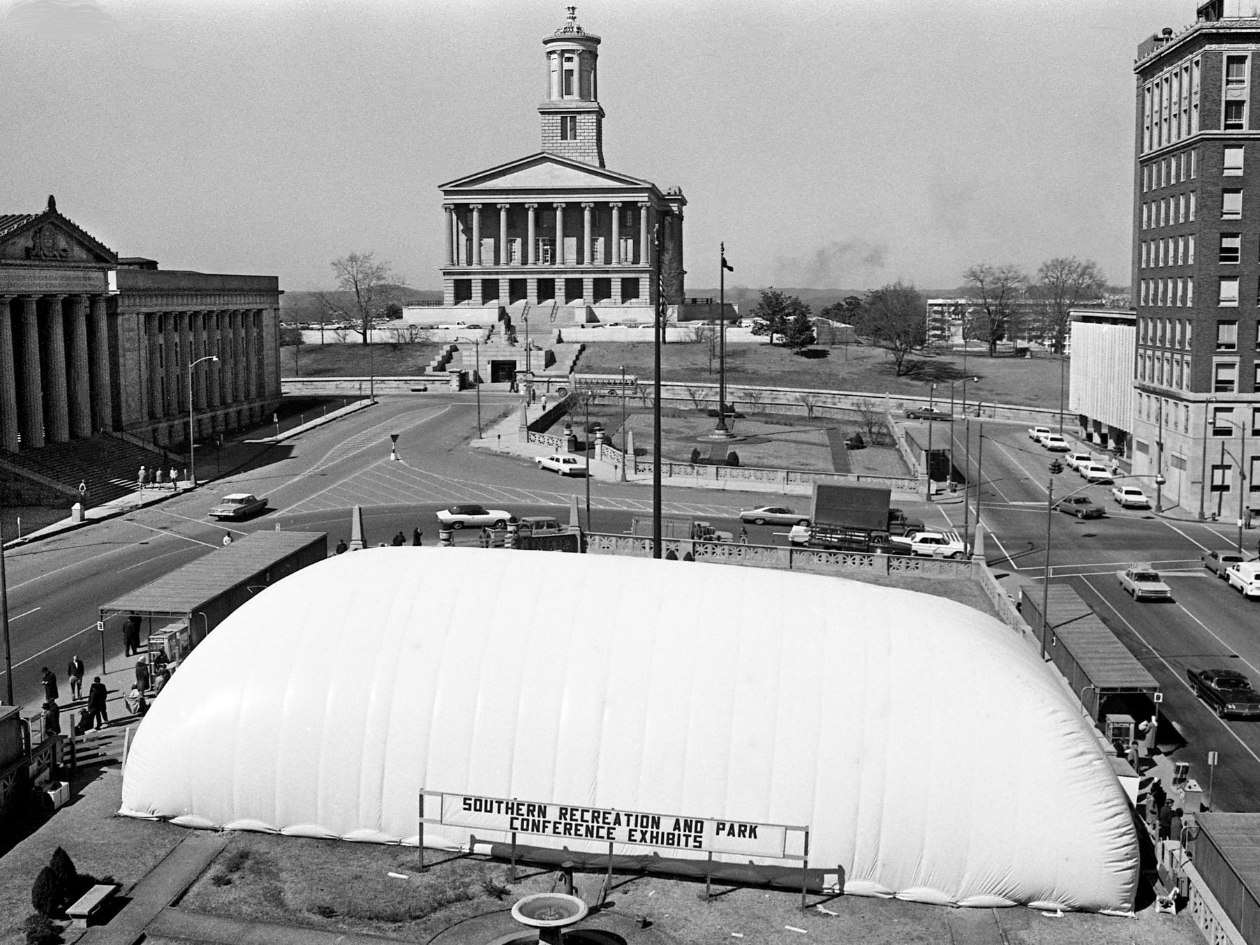It looks like someone is planning a circus for Victory Memorial Square, but it's a giant collapsible plastic building, here March 1, 1968, supported by air to house exhibits for the third annual Southern Recreation and Park Conference across the street from conference headquarters in the Andrew Jackson Hotel.