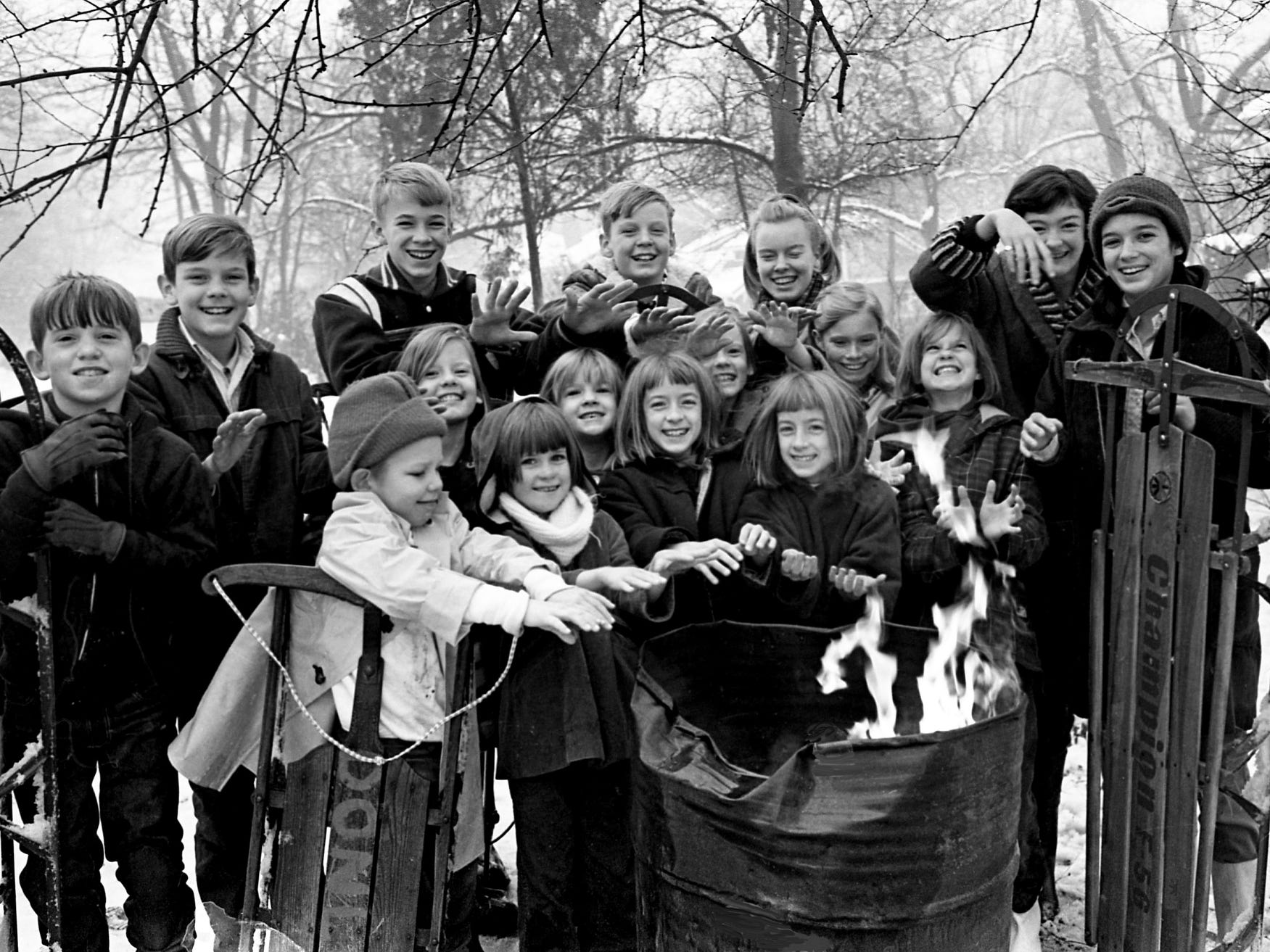 "The self-proclaimed ""Primrose Gang,"" a group of snow-loving youngsters from the Primrose Avenue area, whoop it up around a warm fire during a timeout in holiday fun Jan. 1, 1968."