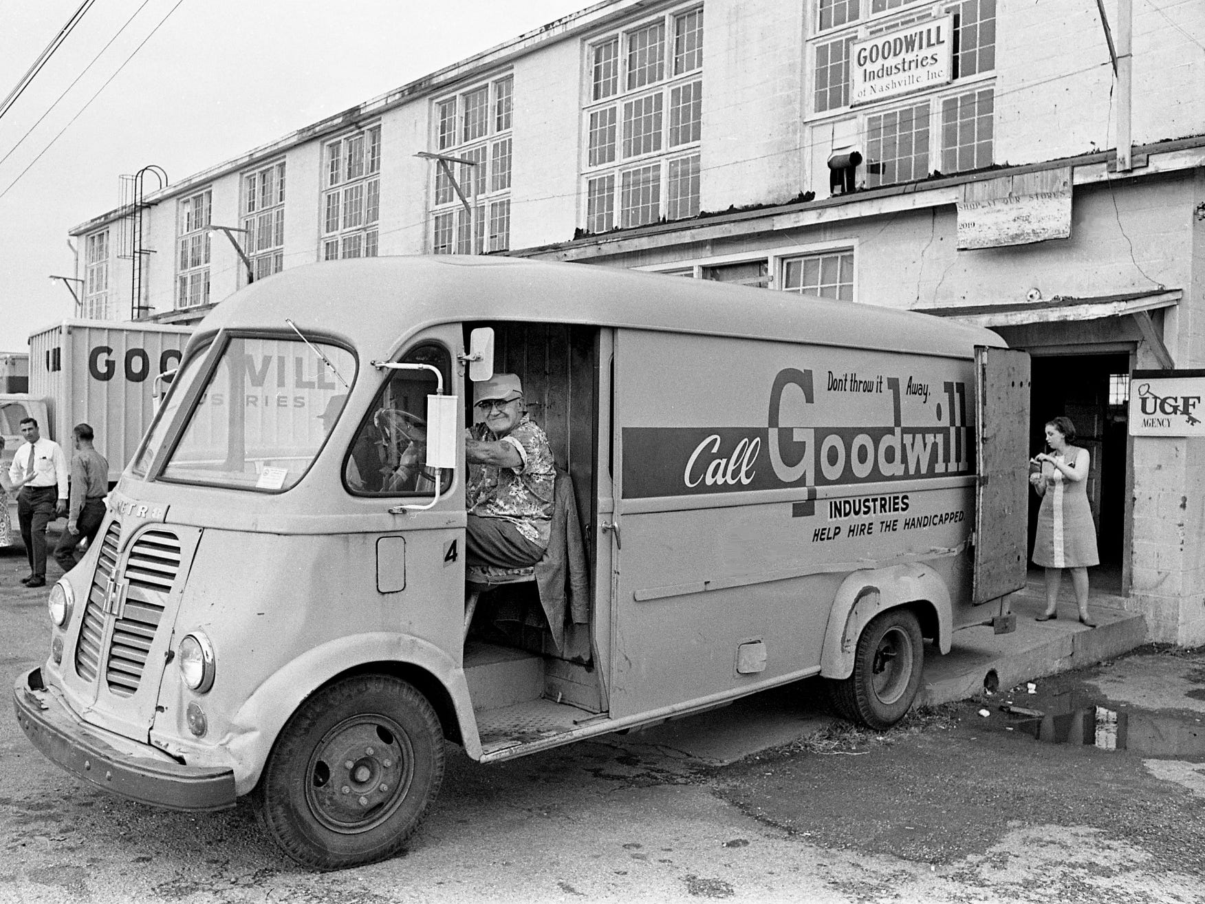 A Goodwill Industries truck backs up to the company warehouse on White Bridge Road on Oct. 7, 1968, with another load of donated goods.