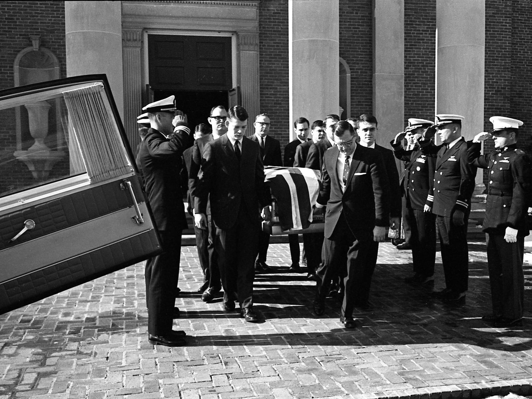 The six remaining members and the commander of the Navy's Blue Angel precision flying team salute their fallen member, William F. Worley, after services at First Presbyterian Church in Nashville on Jan. 18, 1968. Worley, a native of Nashville, died Jan. 14 when his F11A Tiger jet crashed in a Southern California desert during winter training at the naval air facility at El Centro.