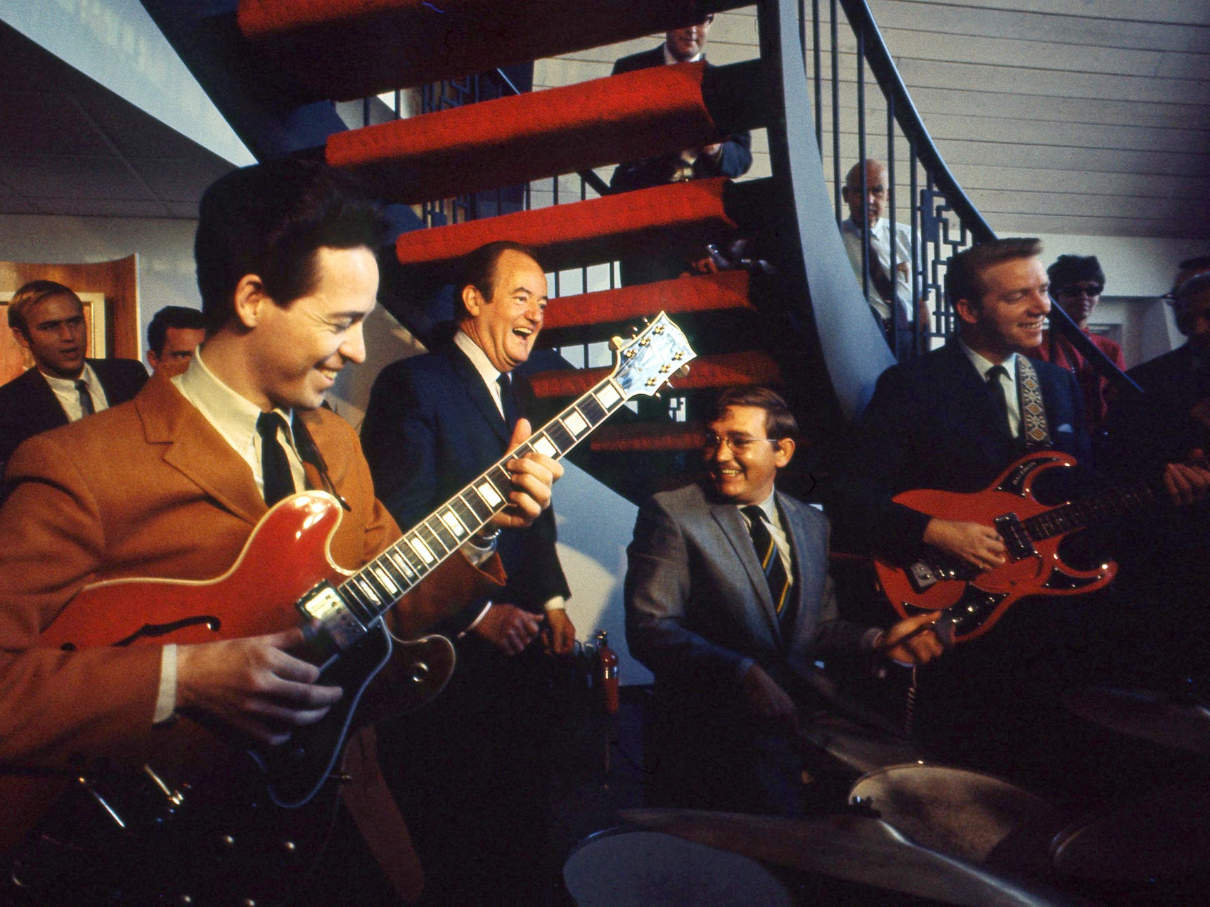 Vice President Hubert H. Humphrey, center, enjoys music during a tour of the Country Music Hall of Fame on his presidential campaign to Nashville on Oct. 1, 1968. The improvised group of musicians included Wade Phillips on guitar, Willie Ackerman on drums and Bob Browning on bass.