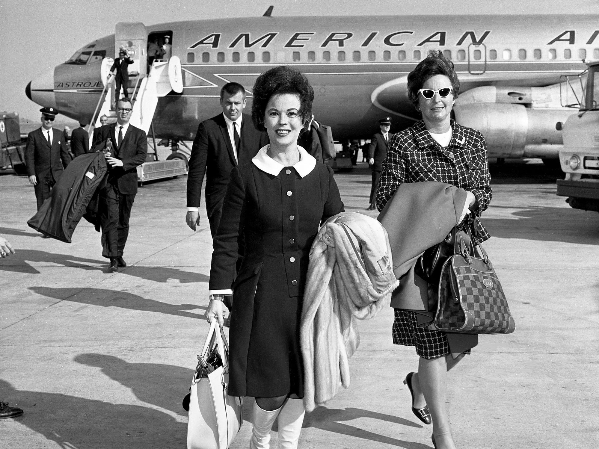 Shirley Temple Black, left, child star turned Republican crowd raiser, arrives at the Nashville Municipal Airport on March 8, 1968, with her traveling companion, Mrs. George Stewart, en route to Chattanooga to address a $100-a-plate GOP fundraising affair.