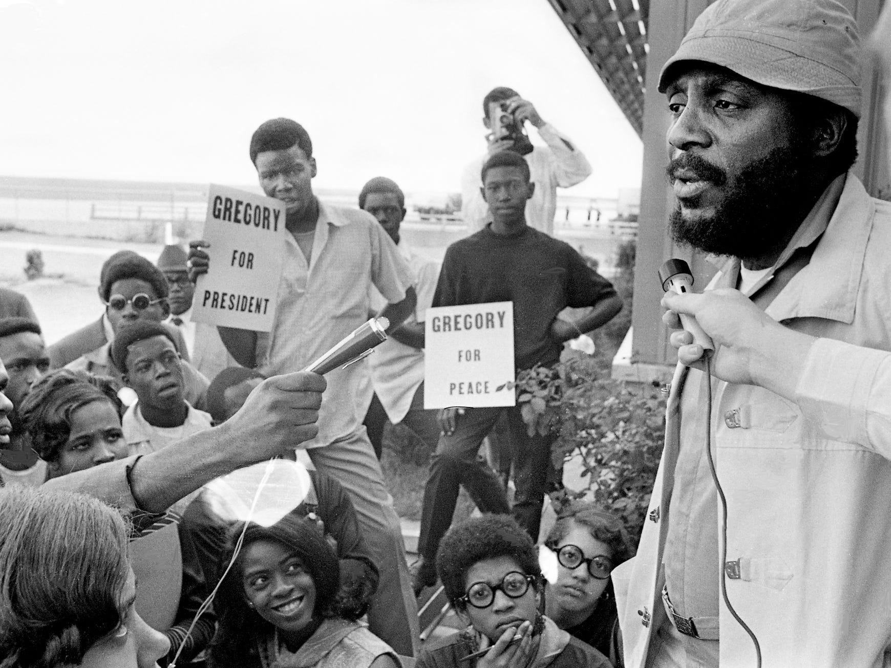 Dick Gregory, the former comedian who is now running for president, answers questions during a news conference after arriving at Nashville Municipal Airport on Sept. 27, 1968. Gregory was in town for an appearance at Vanderbilt University.