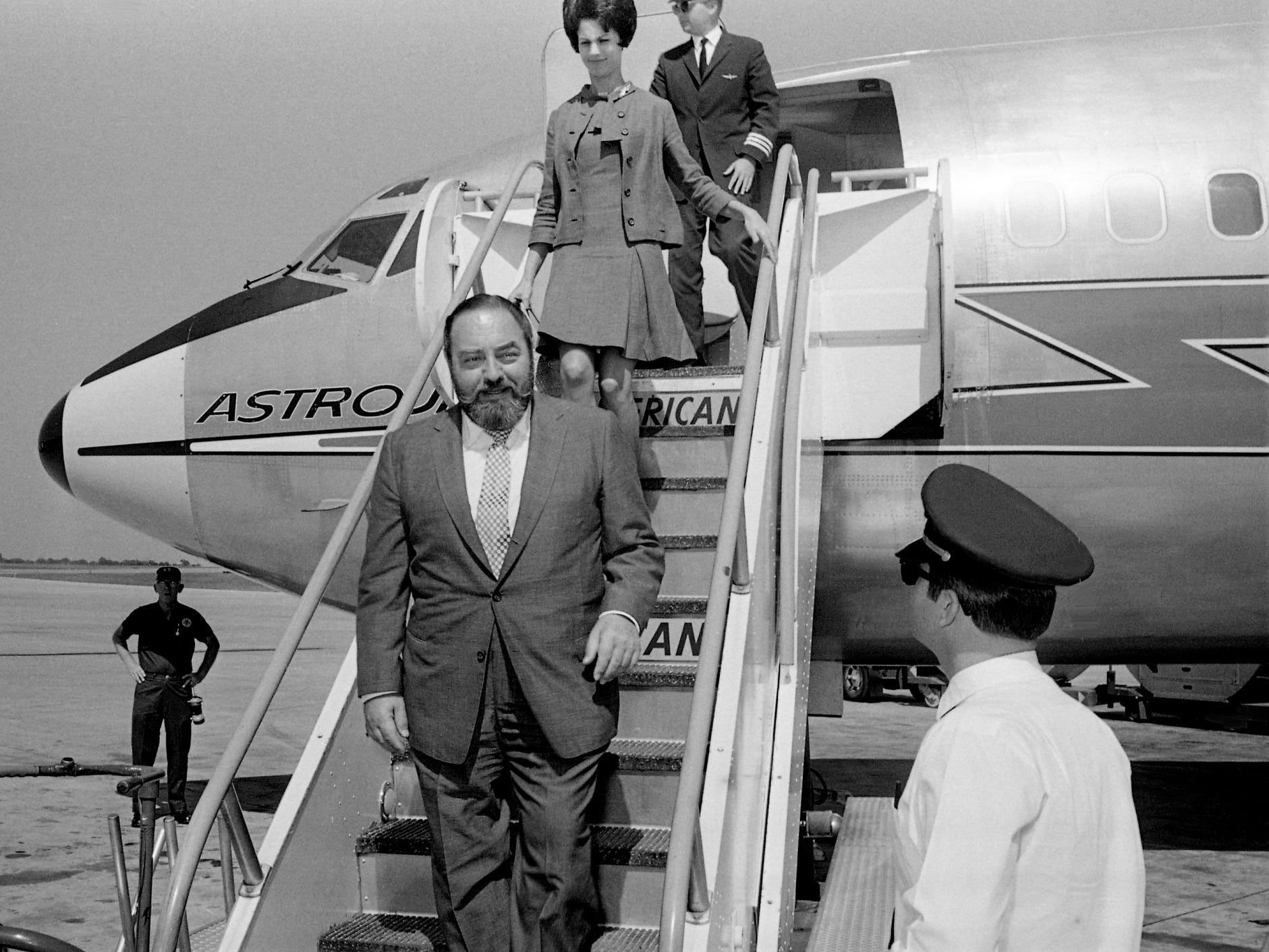Television and motion picture star Sebastian Cabot, front, arrives at Nashville Municipal Airport on Aug. 28, 1968. Cabot was in town for a national meeting of the Schertle Galleries franchise, a subsidiary of LIN Broadcasting Corp., for which he was just named a curator.