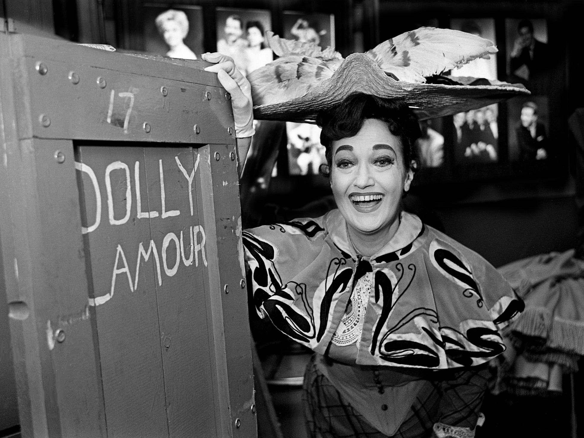 "Flashing her warm, wide smile, actress Dorothy Lamour opens in Nashville in the first of four performances of ""Hello, Dolly!"" at the Ryman Auditorium. She poses backstage May 27, 1968, with one of the costume crates for the elaborately staged musical. The play is Lamour's first legitimate stage role and her first stint at touring."