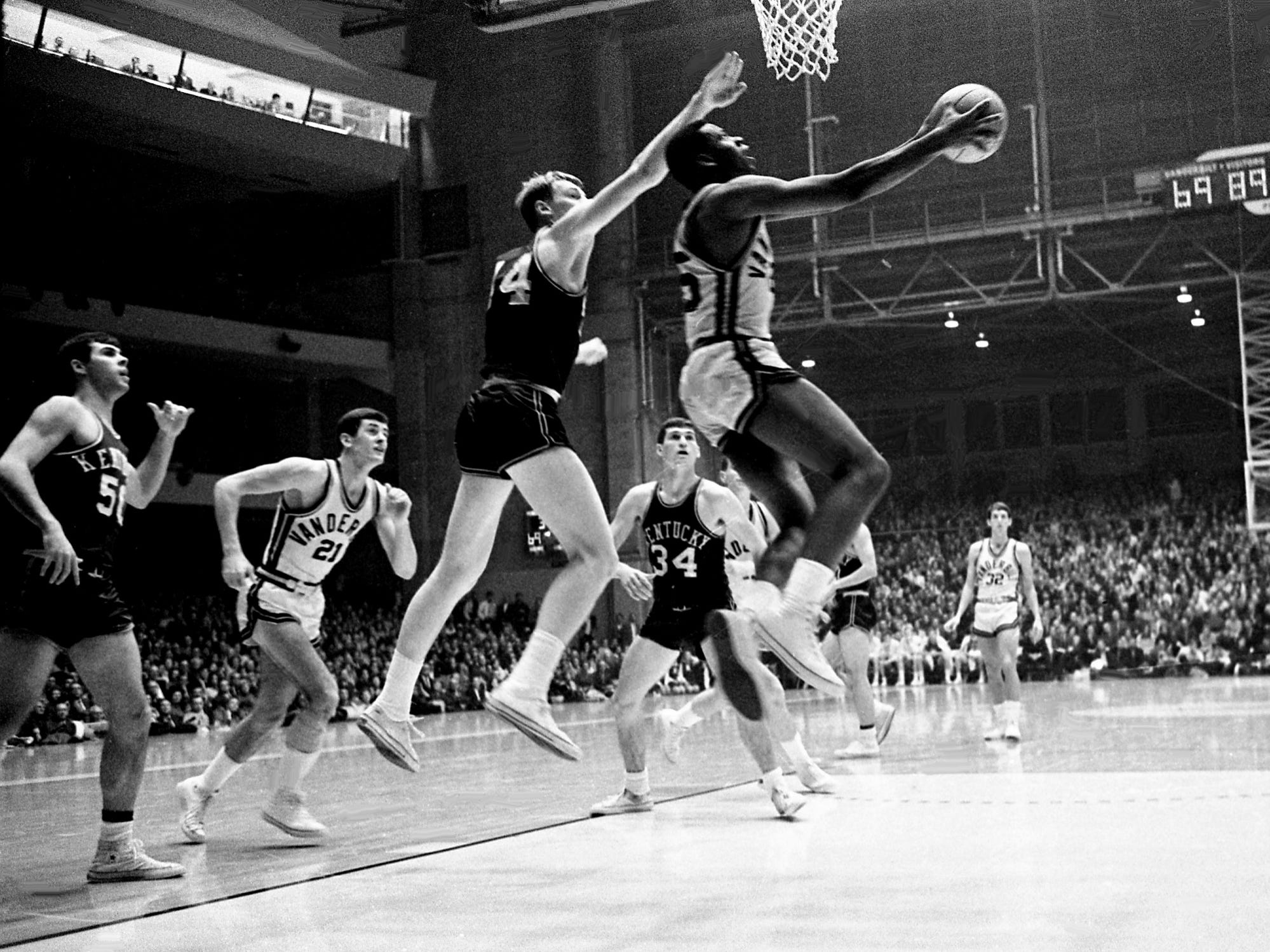 Vanderbilt sophomore Perry Wallace (25) makes a move for a layup as Kentucky sophomore Dan Issel (44) defends. But it was Kentucky all the way in a 94-78 victory over the Commodores before 11,500 at Memorial Gym on Jan. 6, 1968.