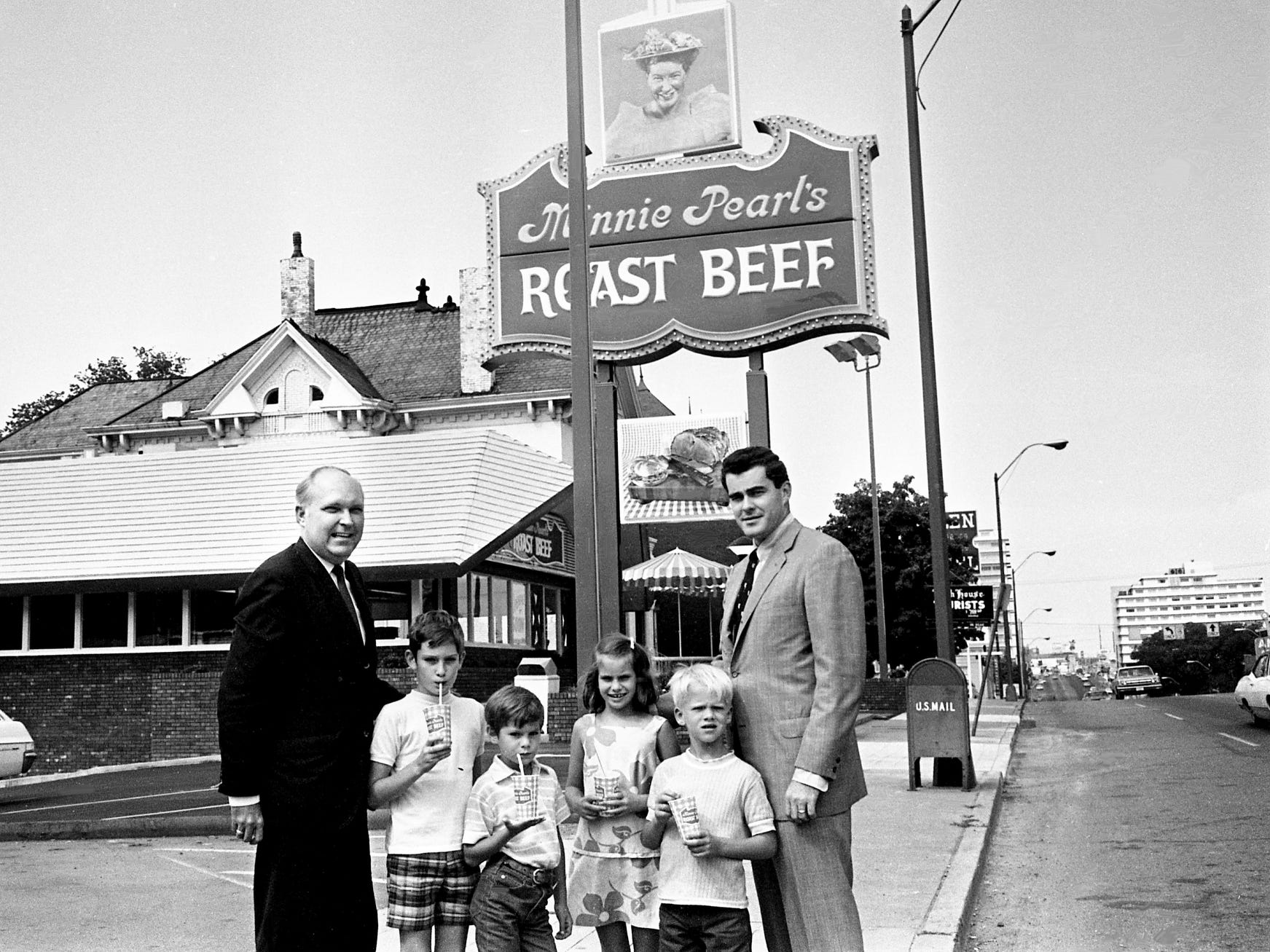 "Minnie Pearl's Roast Beef Co. Inc. officials Don Wells, left, and Jack A. Pirrie, right, hold an impromptu ""investors"" meeting in front of their new roast beef sandwich franchise at 2014 West End Ave. on July 13, 1968. Young ""investors"" in attendance are John Jay Hooker Buchtel, left, Timothy Ingram Hooker, Lisa Hooker and Kevin Ingram Hart."