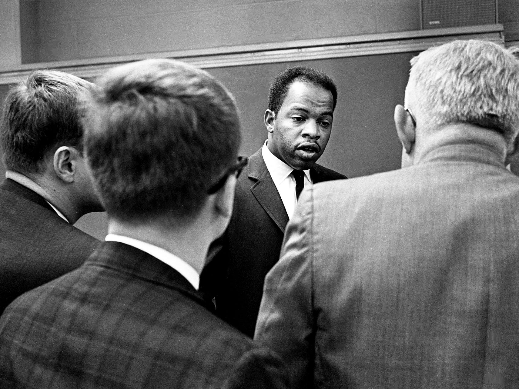 The Rev. John Lewis, center, answers questions after speaking to students and faculty of Vanderbilt University divinity school on campus May 3, 1968. Lewis was head of the Student Nonviolent Coordinating Committee until early 1966 when he was ousted in favor of Stokely Carmichael's more militant stance.