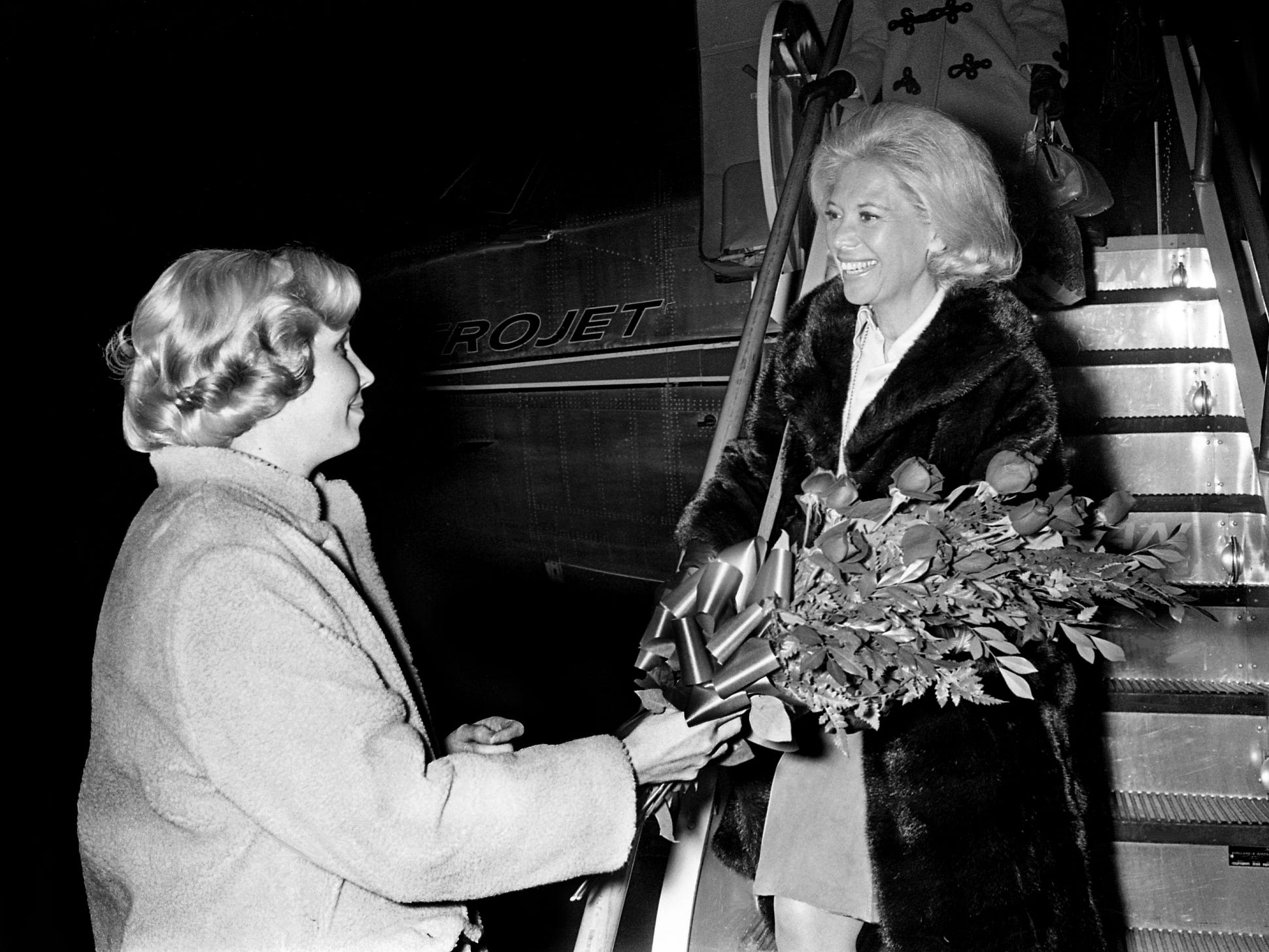 Hometown girl, entertainer Dinah Shore, right, is welcomed home with roses after arriving at Nashville Municipal Airport on Nov. 19, 1968. She returned home to record her first country music and western record and headline the Dinah Shore-Nashville Symphony Pops concerts.