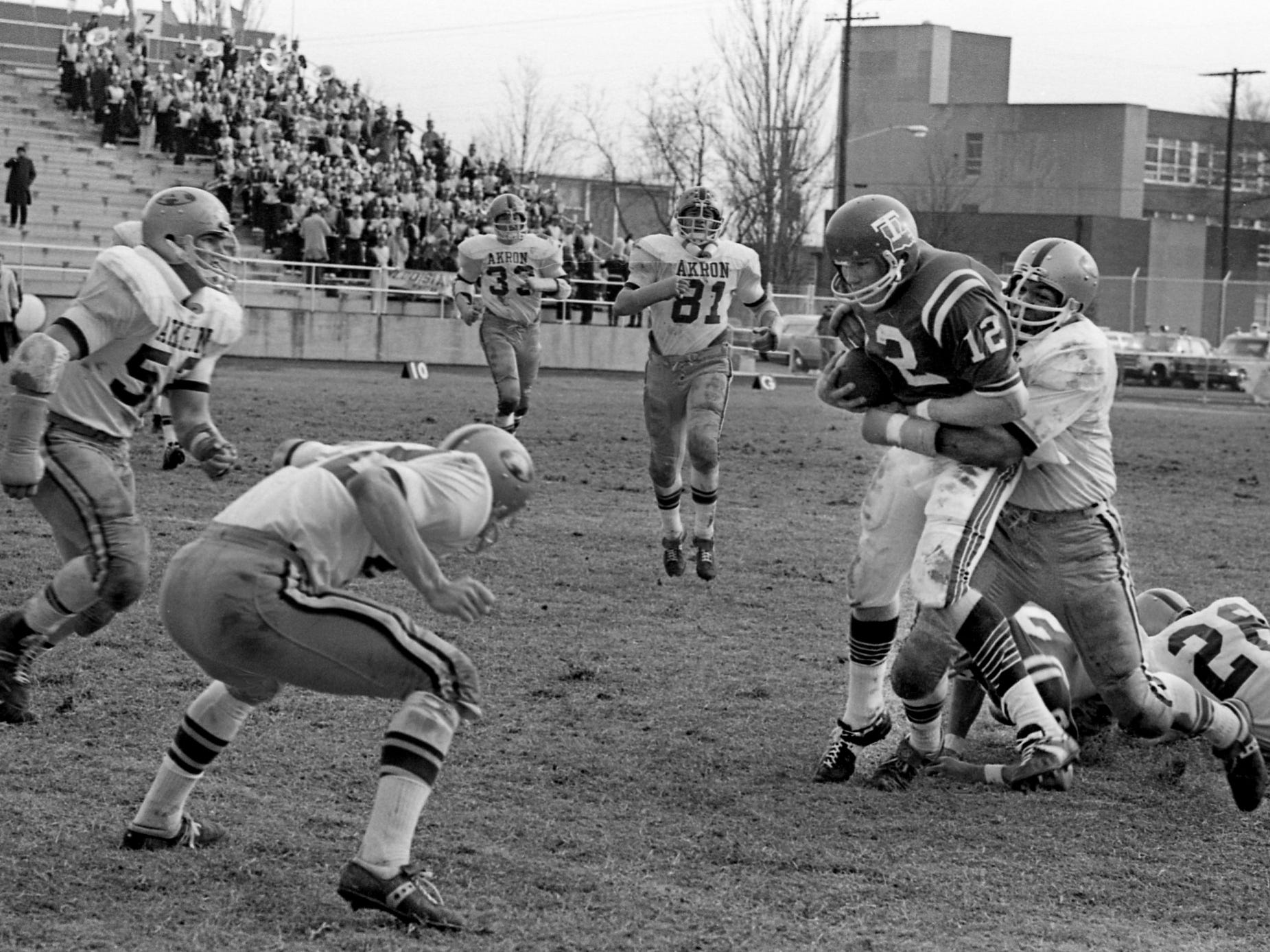 Louisiana Tech quarterback Terry Bradshaw (12) is surrounded by a group of Akron defenders as he leads his team to a 33-13 victory in the fifth annual Grantland Rice Bowl at Middle Tennessee State University on Dec. 14, 1968. Bradshaw passed for two touchdowns and ran in two more.