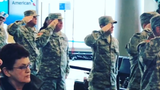 As children who lost a parent in combat embarked on a trip to Disney World, the Nashville International Airport paused for the national anthem.