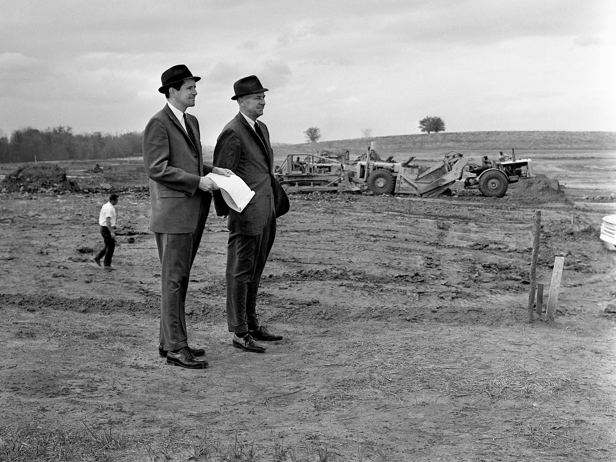 Charles M. Piggott, left, president of Pacific Car and Foundry Co., and G.M. Lahmon, vice president and treasurer, check on development at the construction site of the company's truck manufacturing plant on Anderson Lane in Madison on Oct. 17, 1968. They expect to start producing heavy-duty over-the-road Peterbilt trucks with 400 local employees in its plant July 1, 1969.