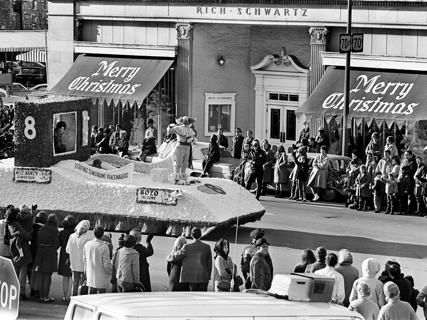 Bozo the Clown, center, and Miss Nancy, left, on the Channel 8 float, wave to the kids lining the street in front of the Rich-Schwartz store during the 16th annual Nashville Christmas Parade on Dec. 8, 1968.