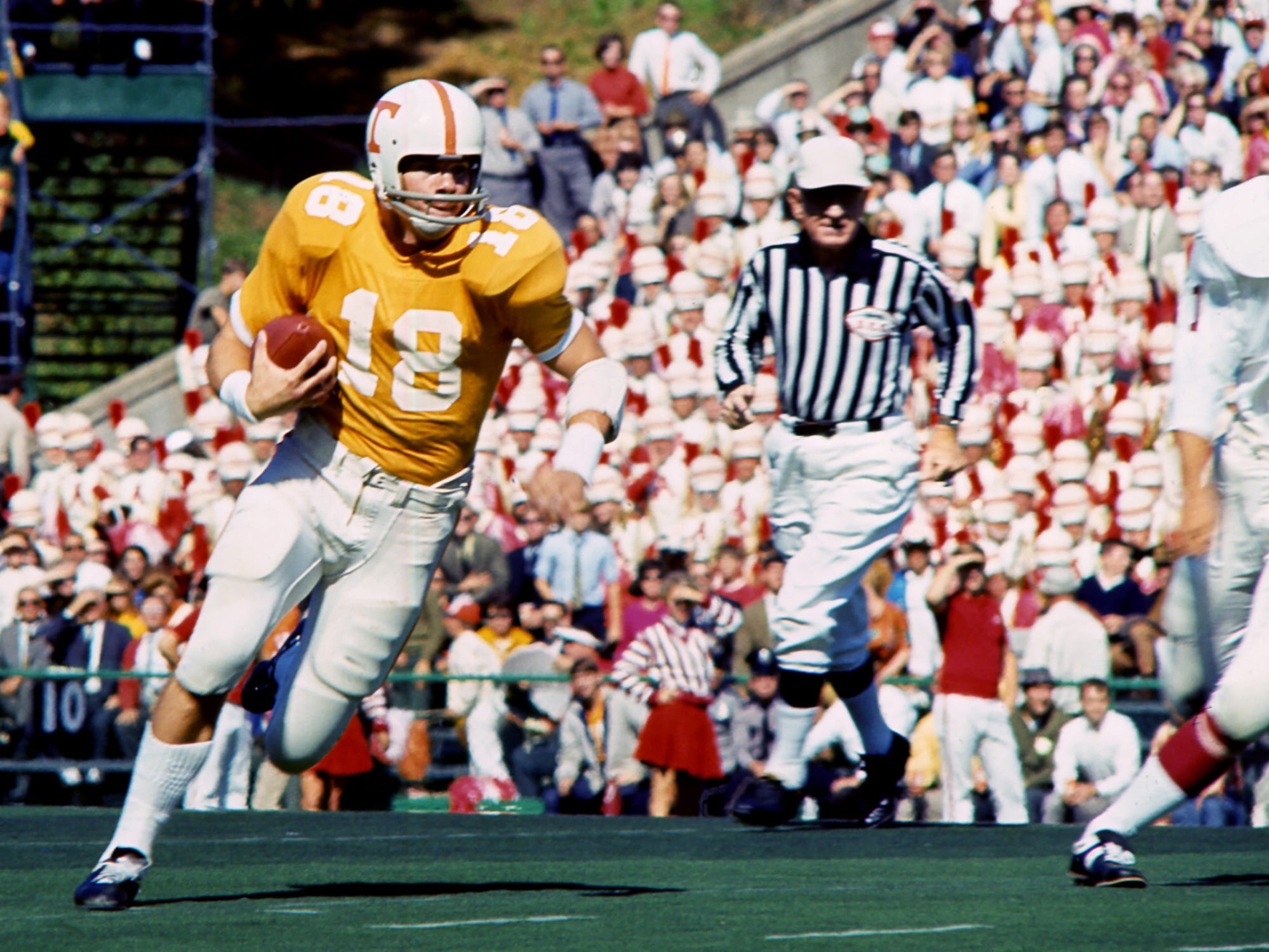 Tennessee senior quarterback Bubba Wyche (18) takes off running against Alabama. Wyche was 13 of 22 for 100 yards passing as Tennessee survived a missed two-point conversion, an onside kick and a missed field goal in the final minute and 12 seconds to win 10-9 before 63,392 fans at Neyland Stadium on Oct. 19, 1968.