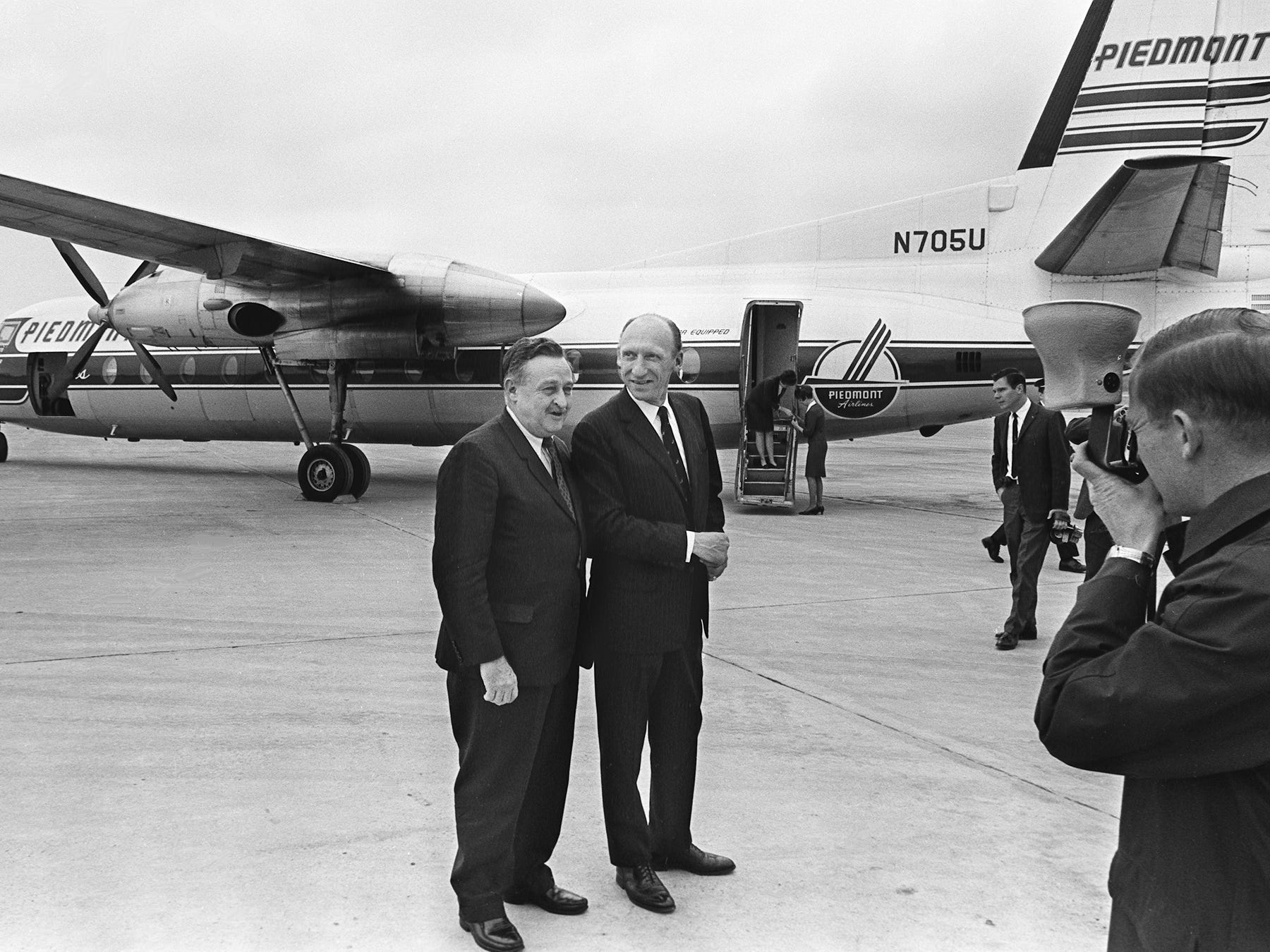 Mayor Beverly Briley, left, and Metro Airport Director Homer Anderson pose in front of the Piedmont plane Feb. 1, 1968, that just made its inaugural 10:10 a.m. flight from the Carolinas to Nashville before going on to Memphis. The flight is one of six new flights serving Nashville daily for Piedmont Airlines.