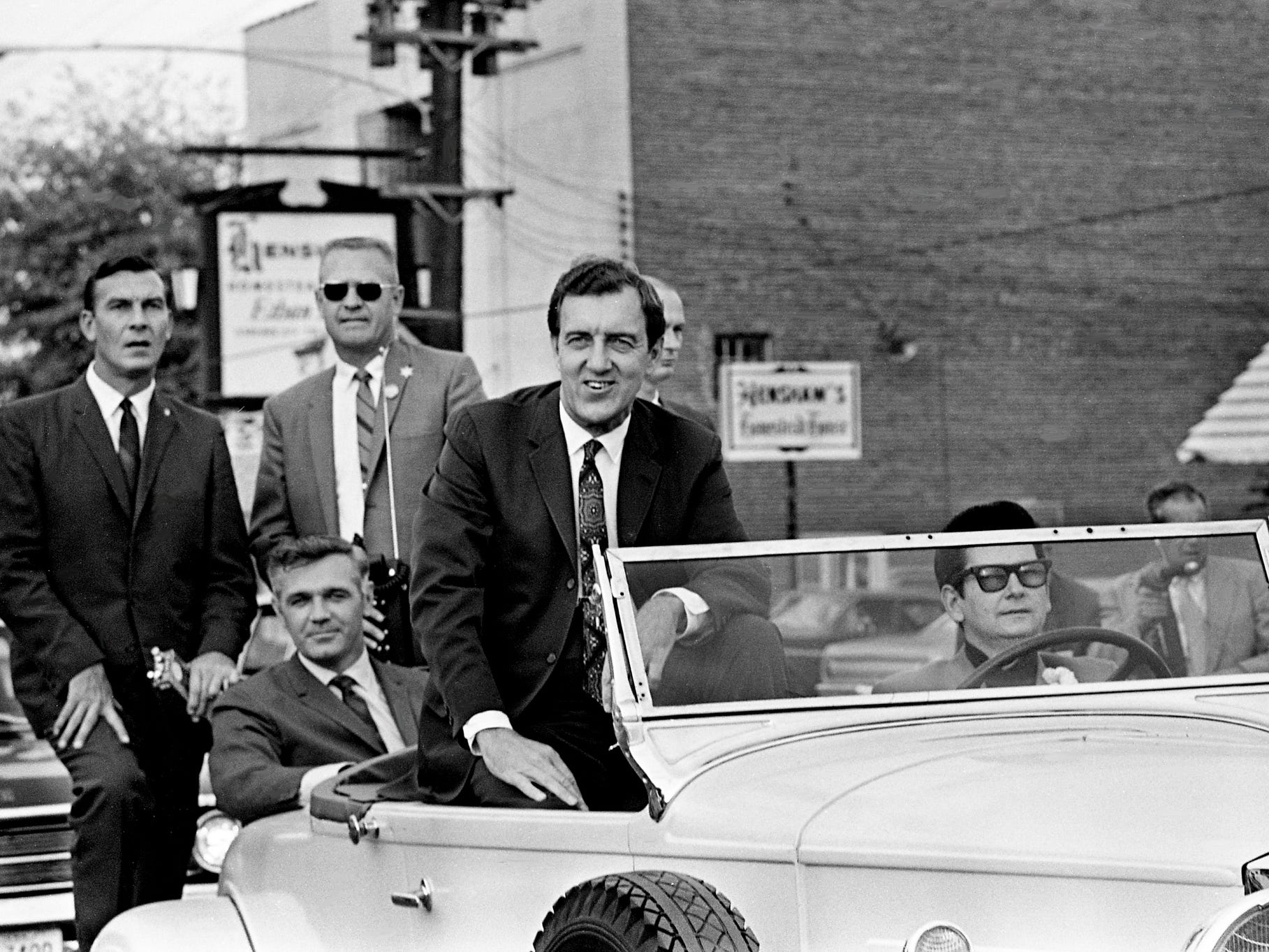 Sen. Edmund Muskie, front left, the Democratic vice presidential nominee, rides in the front seat of a 1930 Packard, chauffeured by entertainer Roy Orbison, during the parade of Madison's 16th annual Hillbilly Day celebration Oct. 5, 1968. Riding in the back is Rep. Richard Fulton.