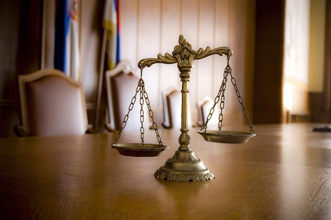 Getty Images / iStockphoto Scales of justice