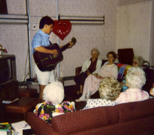 Brad Paisley, 19, plays for patients at Reynold Memorial Hospital in Glen Dale, W.Va., on Aug. 6, 1991.