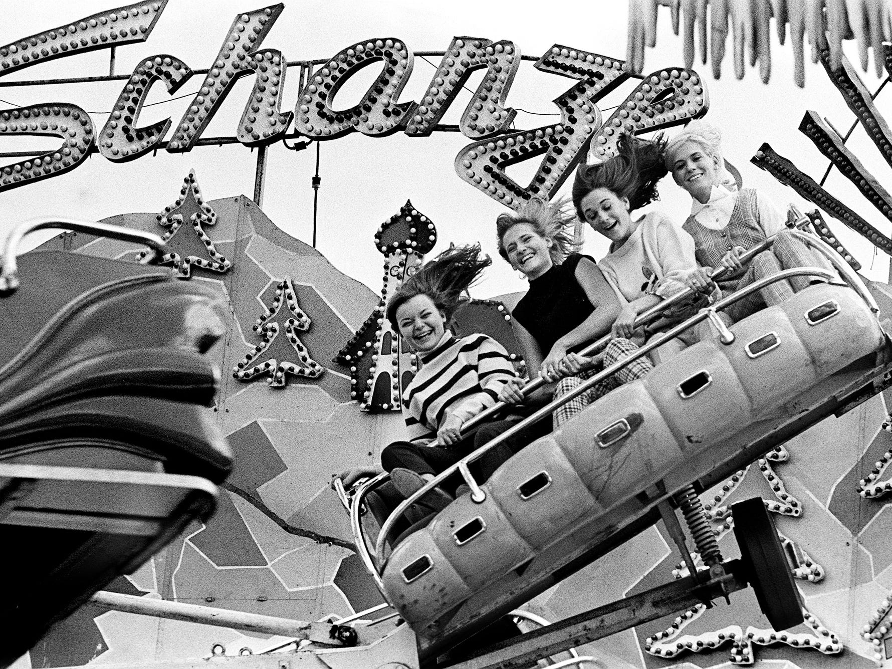 "Hartsville High School cheerleaders Theresa Howell, left, 17, Betty Ray, 16, Nancy Thompson, 15, and Rosie Clift, 17, take a whirl on the ""Sprung Schanze,"" one of the new rides at the Tennessee State Fair, on Sept. 18, 1968."