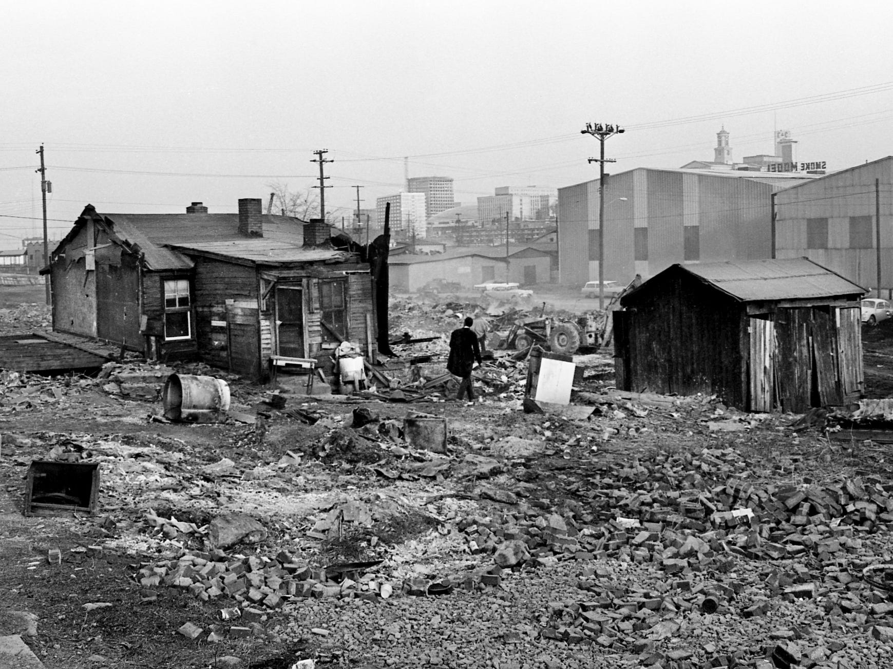 "A resident of the slums at Tenth Avenue and Herman Street prepares to move his meager possessions from a shack in the area Feb. 22, 1968. One of Nashville's worst housing sections is disappearing from the scene and the first stage of the ""Ireland Street Project"" of Mayor Beverly Briley is set to begin."
