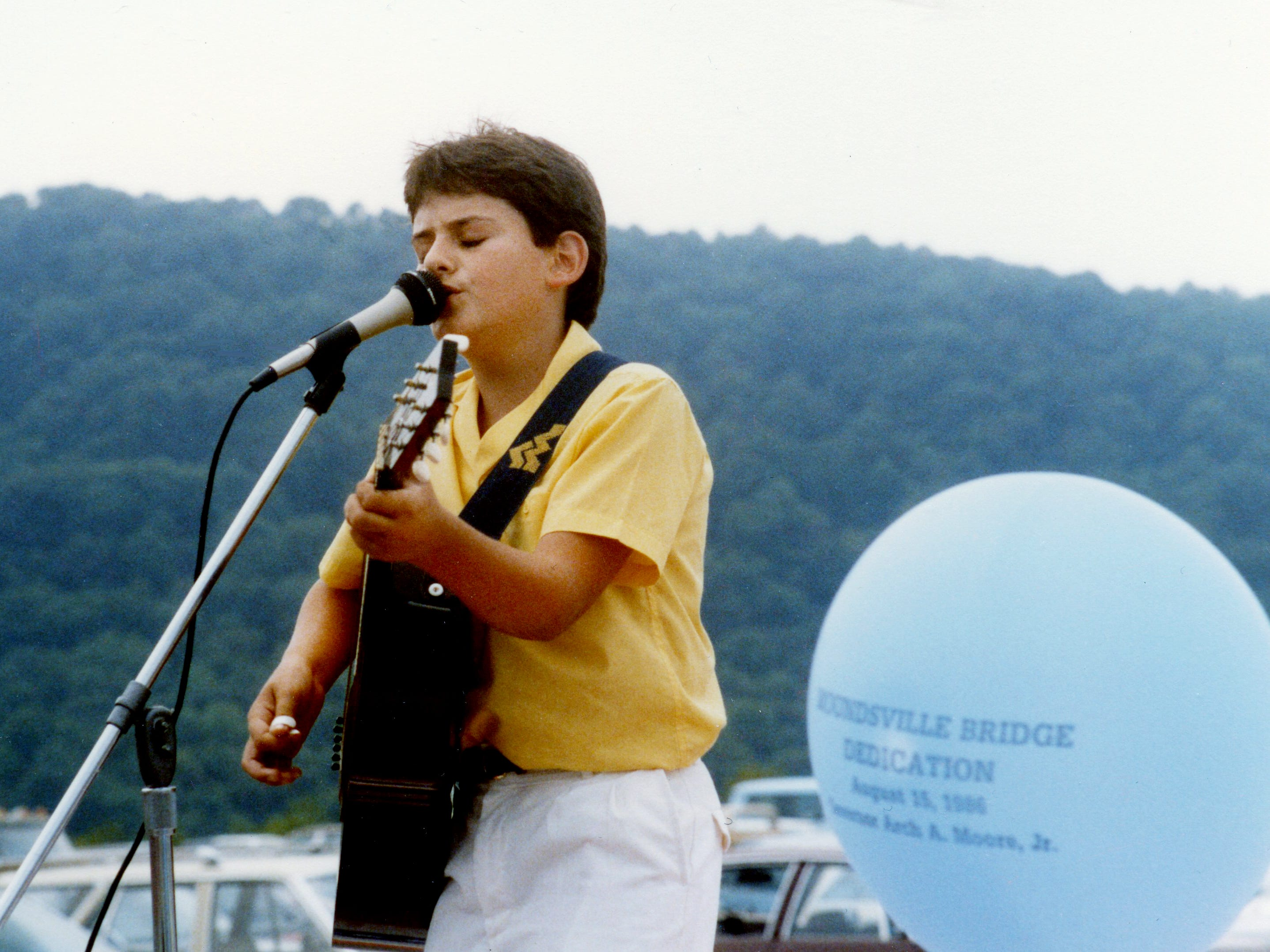 Brad Paisley, 15, plays for a bridge dedication Aug. 15, 1986, in Moundsville, W. Va.