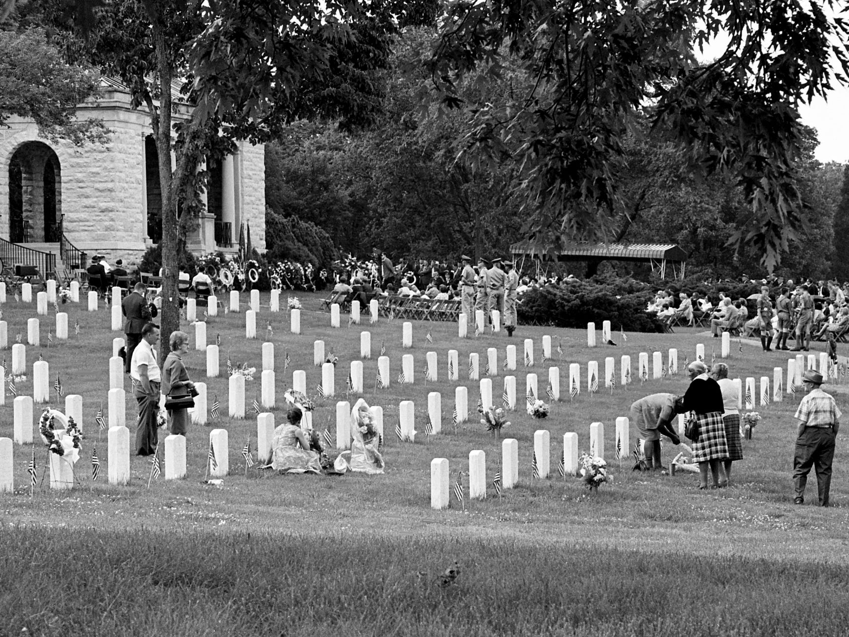 Family members visit the graves of their loved ones as others wait for the start of Memorial Day services at the National Cemetery on Gallatin Road on May 30, 1968.