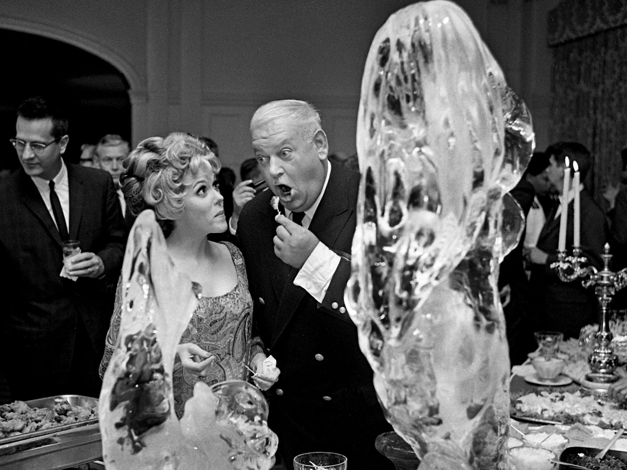"Eileen Fulton, left, who plays Lisa Hughes on ""As the World Turns,"" and John Banner, better known as Shultz on ""Hogan's Heroes,"" share a bite at the buffet table Sept. 27, 1968. Executives of Nashville's WLAC-TV 5 entertained officials of CBS at Belle Meade Country Club."