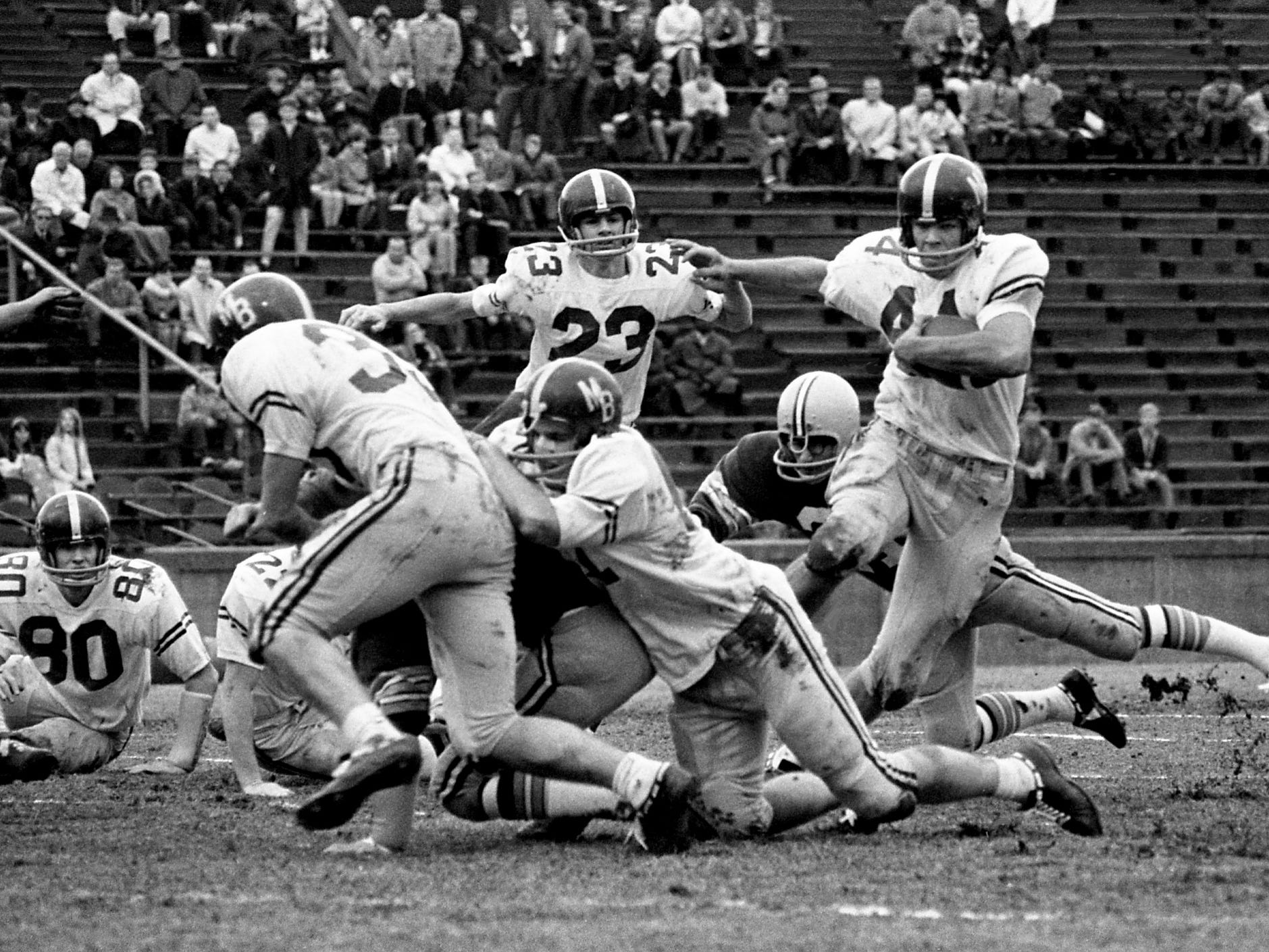 MBA's NIL Back of the Year Jeff Peeples (44) moves away from the pack for some of his 109 yards rushing in their 35-7 victory over Gallatin High in the Clinic Bowl before an estimated 18,000 at Vanderbilt's Dudley Field on Nov. 28, 1968. Peeples was voted MBA's outstanding player in the Clinic Bowl.