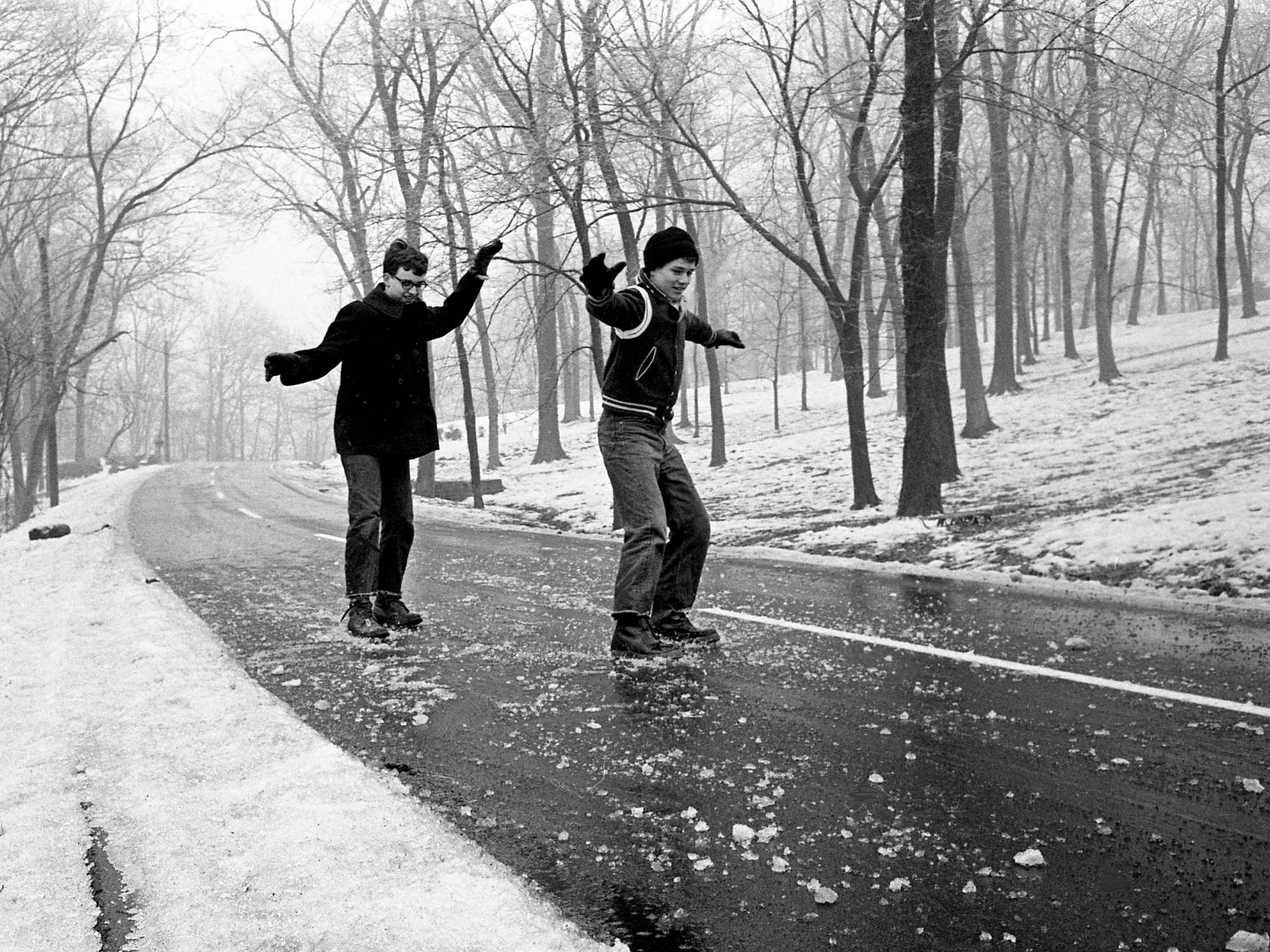 Drew Stewart, left, of Wisconia Drive, and Butch Niederhauser of Summerly Drive, enjoy one of Nashville's icy streets close to home Jan. 11, 1968.