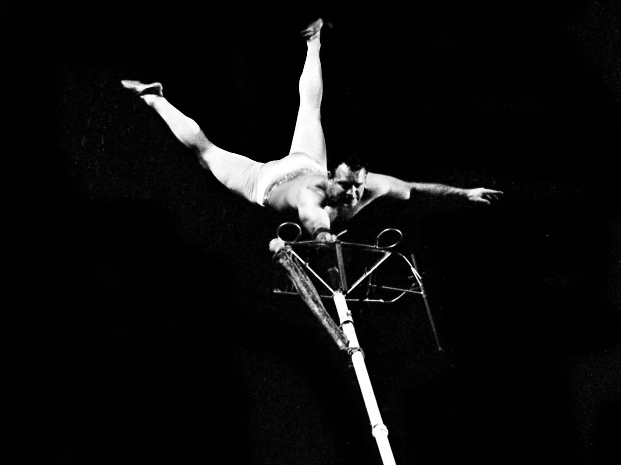 With the greatest of ease, Col. Marvin Seabright, a pole-climbing artist, teams muscle with balance to thrill the crowd high above the floor during the 12th annual Great Lakes of the South Outdoor show at the Municipal Auditorium on Feb. 14, 1968.