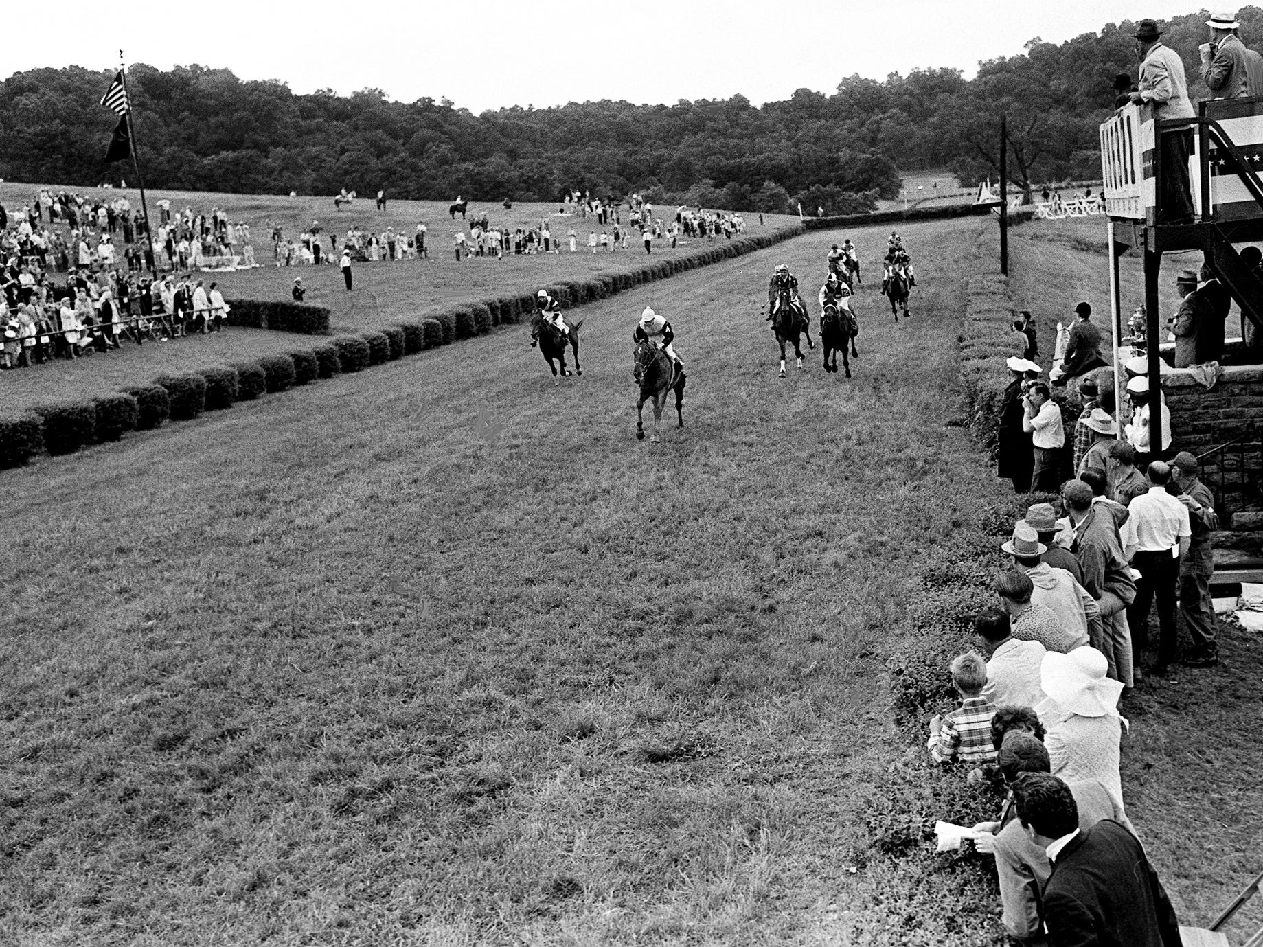 Appollon, with rider Kevin Freeman, is in the lead on the first pass of the judges stand during the Memorial Steeplechase, the main race of the 27th annual Iroquois Steeplechase, on May 11, 1968.
