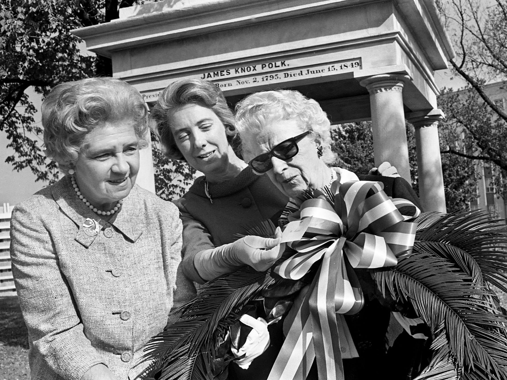 A presidential wreath is placed at the tomb of former President James K. Polk on the grounds of the state Capitol on Nov. 1, 1968. Representing the Polk Memorial Association are Mrs. Jack Bass, left, past president, Mrs. Alex Pirtle, director, and Mrs. A.P. Rhett, president.