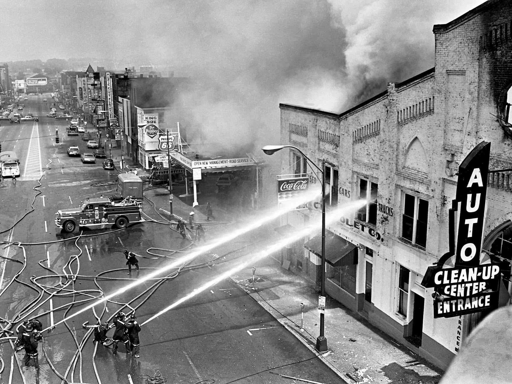 Metro firefighters battle the blaze destroying the Auto Clean-Up Center at 519 Broadway on June 1, 1968. The building used to be used by the Capitol Chevrolet Co. for its truck and used car departments for many years. The dealerships moved to 600 Murfreesboro Road about a month ago.