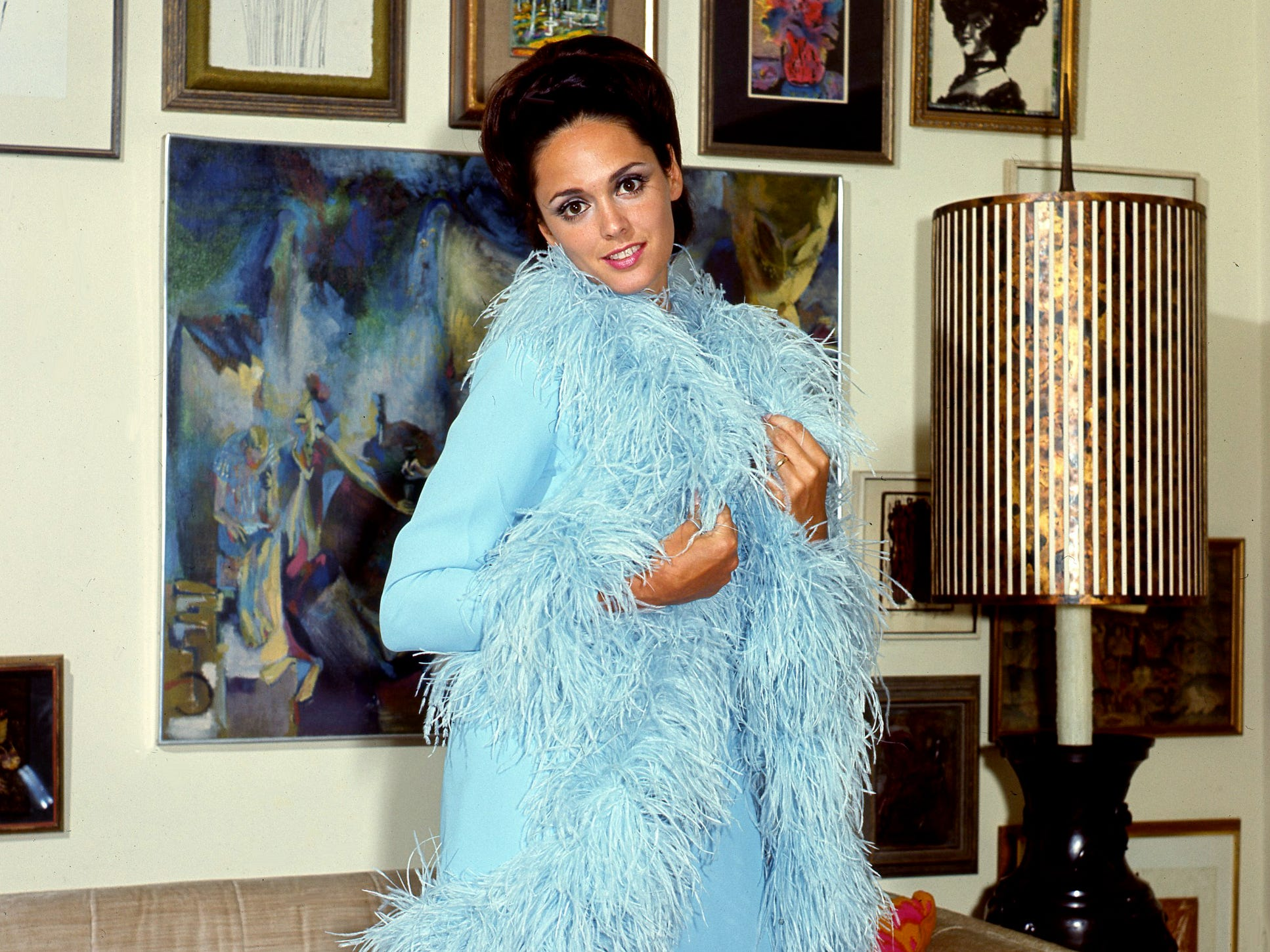 Model Linda Neal shows off a pale blue dress with feathery sleeveless coat Aug. 8, 1968, from the fall collection of California fashion designer Richard Blackwell in Nashville.