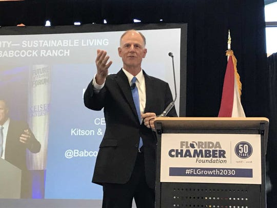 Syd Kitson, CEO of Kitson & Partners, speaks at an infrastructure and growth summit held at Babcock Ranch on Tuesday, Dec. 11, 2018.