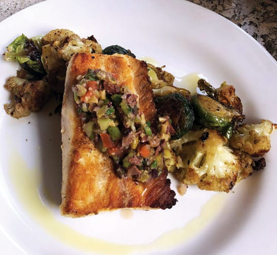 Cobia with Puttanesca relish is the feature dish for December at D'Amico & Sons restaurant in Naples.
