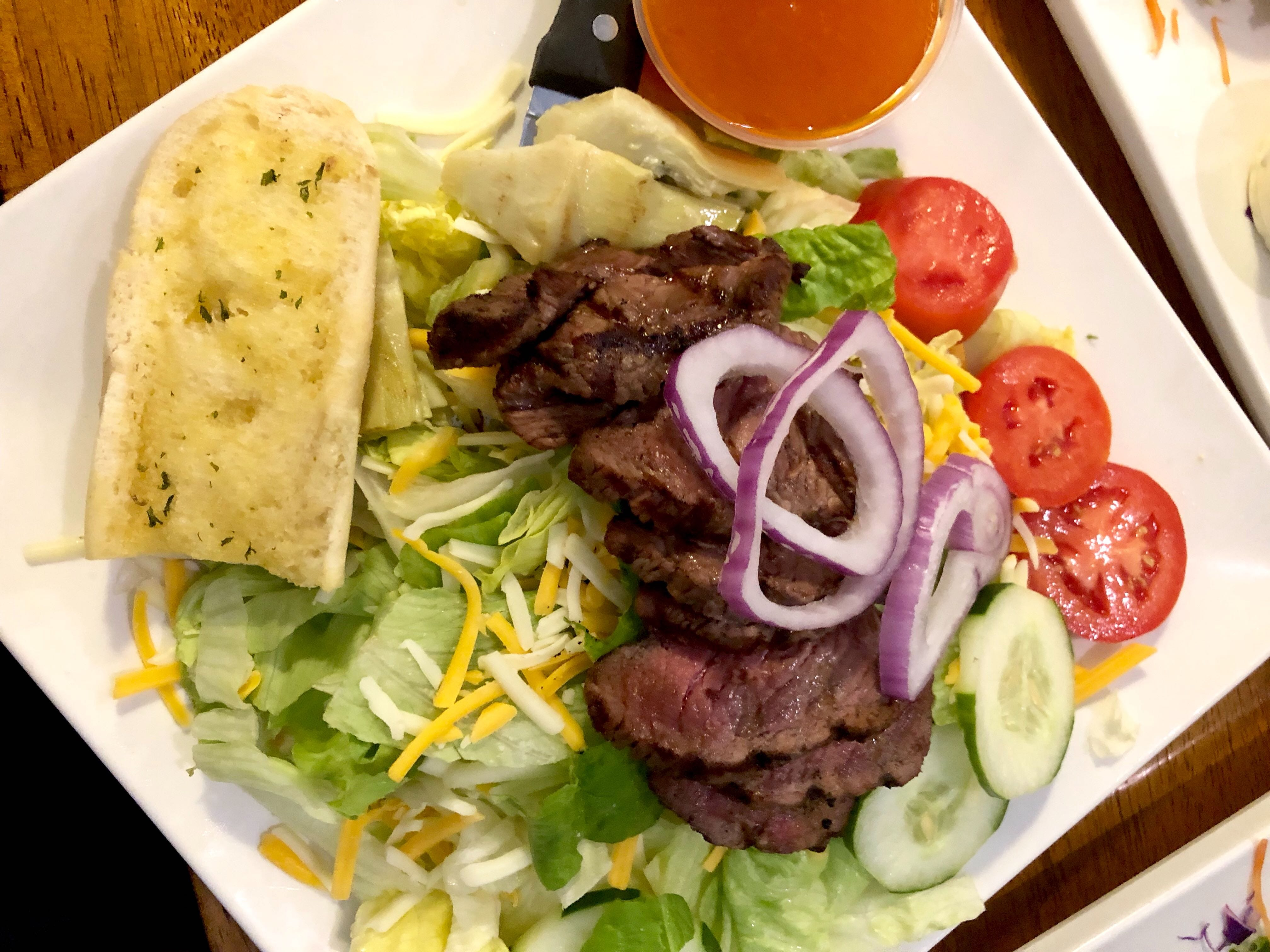 The South Florida salad with charboiled angus steak at  Alice Sweetwater's Bar & Grille.