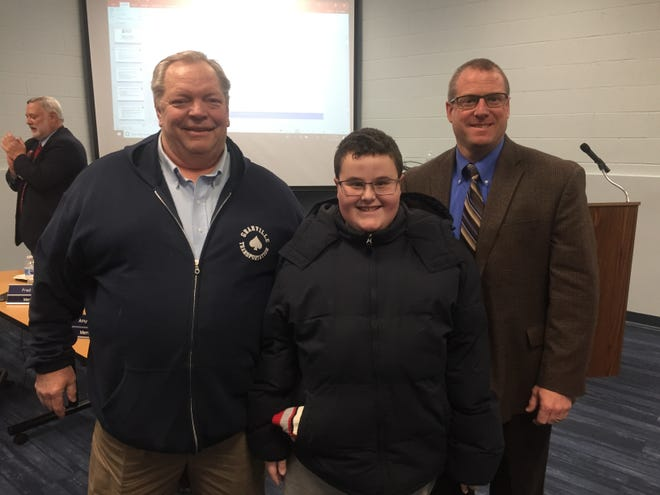 Bus driver Dale Simpson, his grandson, Cameron Wereley, and Granville Schools Superintendent Jeff Brown at the Dec. 10 school board meeting where Simpson was recognized for his quick actions after a car pulled into the path of his bus on Dec. 6.