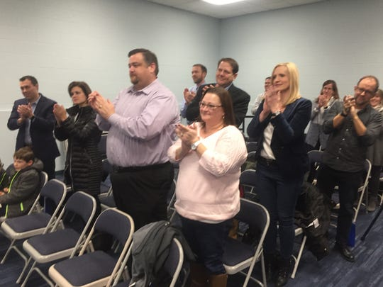 A standing ovation is given Dale Simpson at the Dec. 6 Granville Board of Education meeting.