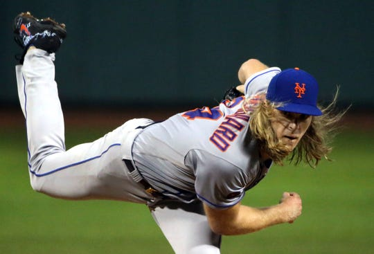 New York Mets starting pitcher Noah Syndergaard delivers to the Boston Red Sox in the first inning of a baseball game at Fenway Park, Friday, Sept. 14, 2018, in Boston.