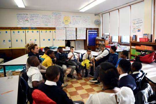 Fourth graders in Kristie Bell's class list positive things about each other to start the school day on Tuesday, Dec. 11, 2018, in Prospect Park.