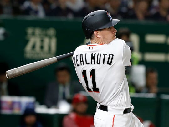 MLB All-Star catcher J.T. Realmuto of the Miami Marlins watches the flight of his three-run home-run off All Japan's pitcher Masaru Sato in the eighth inning of Game 2 of their All-Stars Series baseball at Tokyo Dome in Tokyo, Saturday, Nov. 10, 2018.