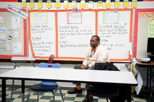 Vernon Maynor, principal of the Young Men's Leadership Academy, sits in on a class on Tuesday, Dec. 11, 2018, in Prospect Park.