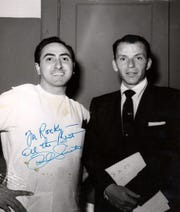 Frank Sinatra with Riviera nightclub barber Rocky Vitella in the early 1950s.