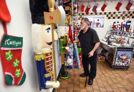 """Big"" Frank Monaco, owner of Big Frank's Homestyle Kitchen, sorts out a few of more than 300 Nutcrackers that are displayed at his deli in North Arlington on 12/11/18."