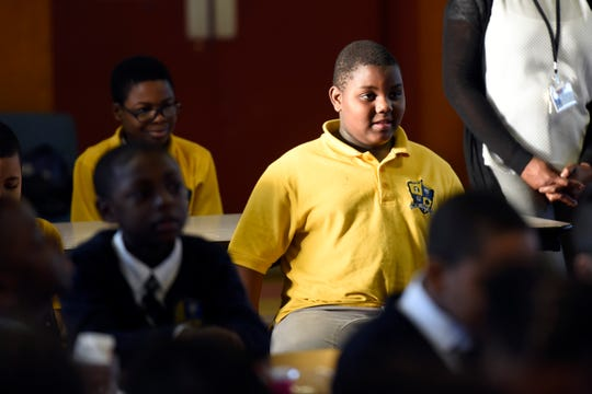 """Messiah Bronson, a student at the Young Men's Leadership Academy, sits in on a """"town hall"""" meeting on Tuesday, Dec. 11, 2018, in Prospect Park."""