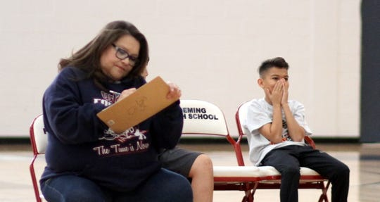 Nathan Quiroz is overcome with emotion upon learning he is the winner of the Deming Elks Hoop Shoot for the boys' age 12-13 division in 2018. Keeping score is Deming Elks member Dolores Teague.