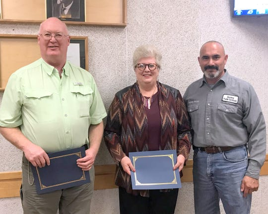 From left are Pastor Brad Reeves, Mary Galbraith and Deming Mayor Benny Jasso. Reeves and Galbraith attended Monday's City Council meeting to accept a certificate of appreciation on behalf of the Ministerial Alliance in Deming. Volunteers painted 541 fire hydrants as a community service project.