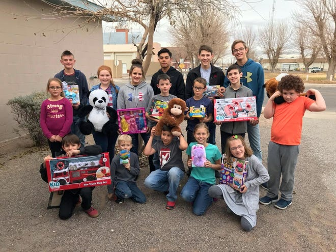 Members of the Gage Gophers 4-H Club collected new toys and gifts for children at Healing House this Christmas.Club members donated a total of 16 items to the local domestic violence shelter. Standingfrom left are: Madison Stevens, Roy Scott Chandler, Calleigh Sweetser, Ciera Wood,Sam Hofacket,Jose Jimenez, Jack Hofacket, Truett Shafer, Joaquin Kriegel, Ivan Schultzand Pierson Delaney.Kneeling from left are: Roman Kriegel, James Donaldson, Rowdy Smrkovsky, Elizabeth Donaldsonand Almarae Schultz.